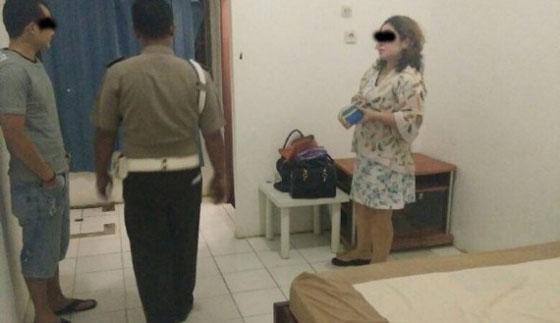 Foto Istri Polisi 'Diembat' Oknum Polisi di Kamar Hotel