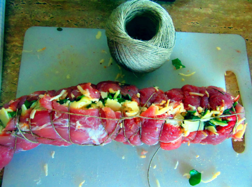 Italian style stuffed pork tenderloin by Laka kuharica: tightly roll up the tenderloin, secure with metal or wooden toothpicks or a string.