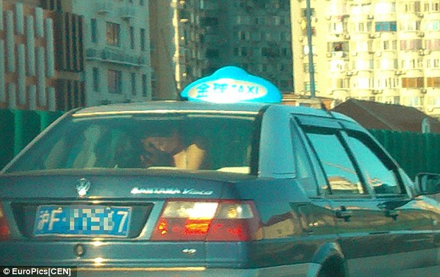 couple having sex in taxi
