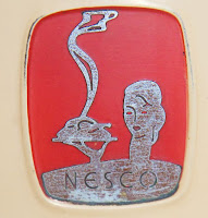 Vintage Nesco electric roaster art deco insignia