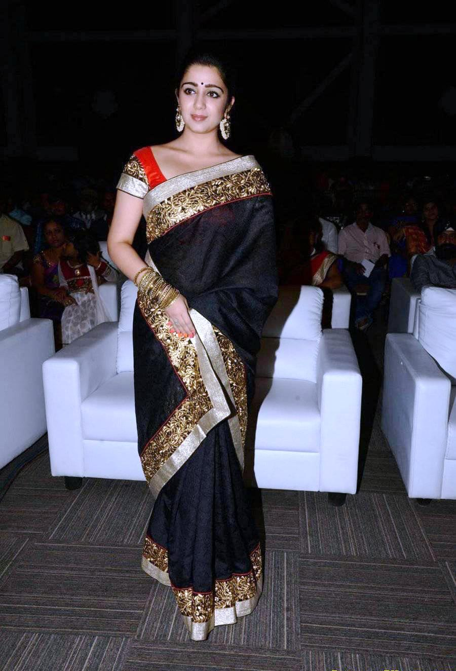 tollywood actress charmy kaur in black saree at audio lunch