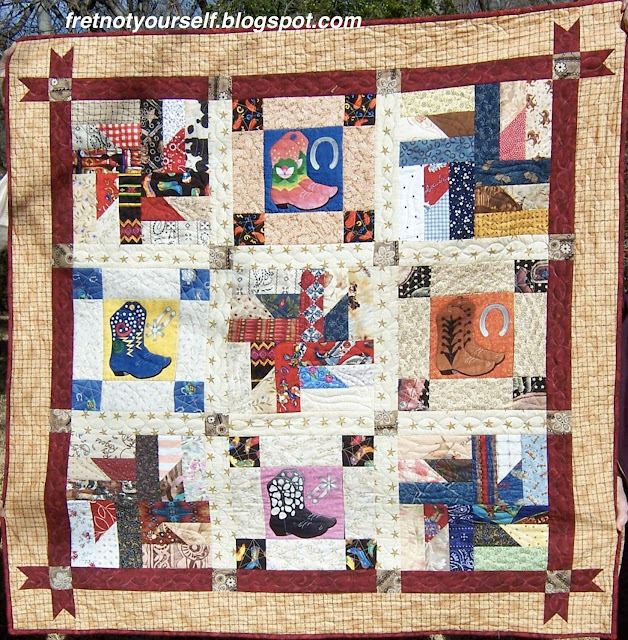 The Puddin' and Pie blocks are alternately set with Boot blocks to create this nine-block baby quilt.