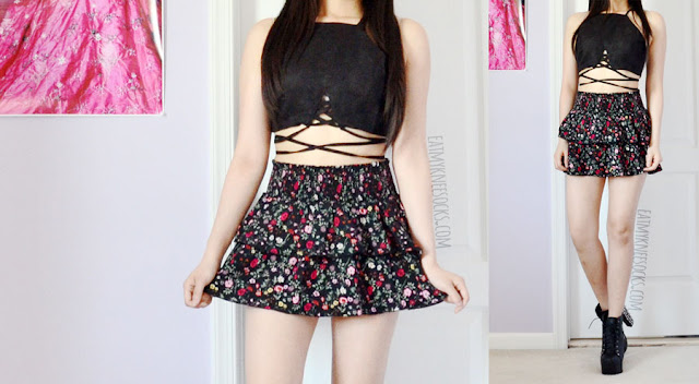 A festival and beach-ready summer outfit featuring Dresslink's faux suede lace-up cutout tie-waist black crop top and a ruffled tiered floral mini skirt from the H&M Coachella collection.