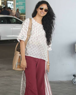 Keerthy Suresh in White and Maroon Dress with Cute Smile Captured at Hyderabad Airport