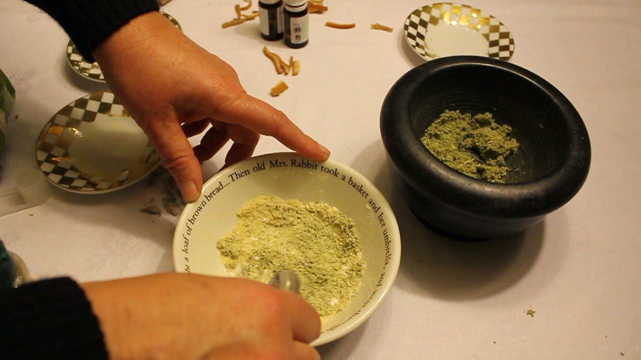 Hand mixing home-made organic tooth powder