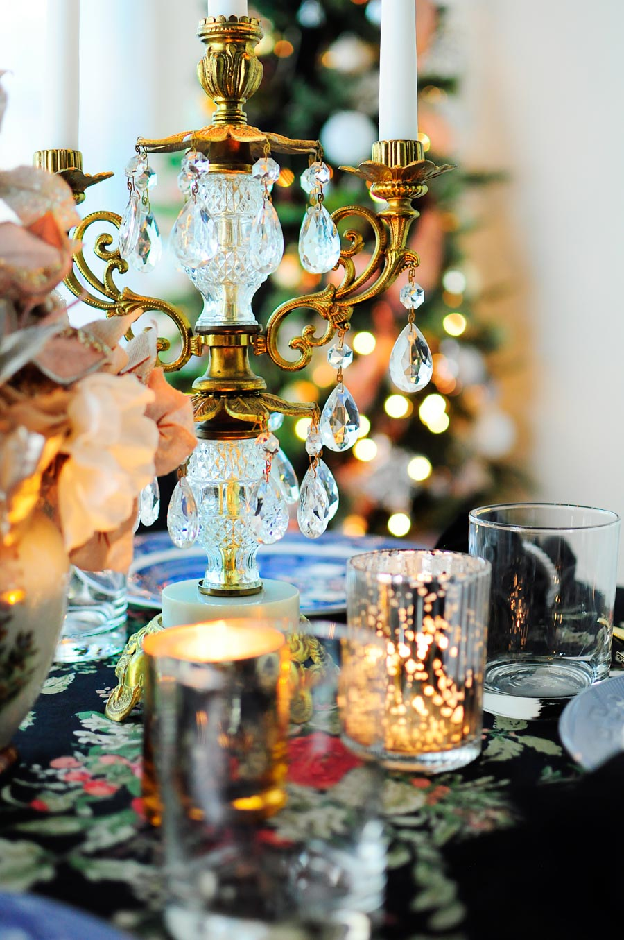 A small dining area is decorated with florals, blush accents, and silver, gold and white ornaments for a truly glam and eclectic holiday space. The chinoiserie touches are fabulous!