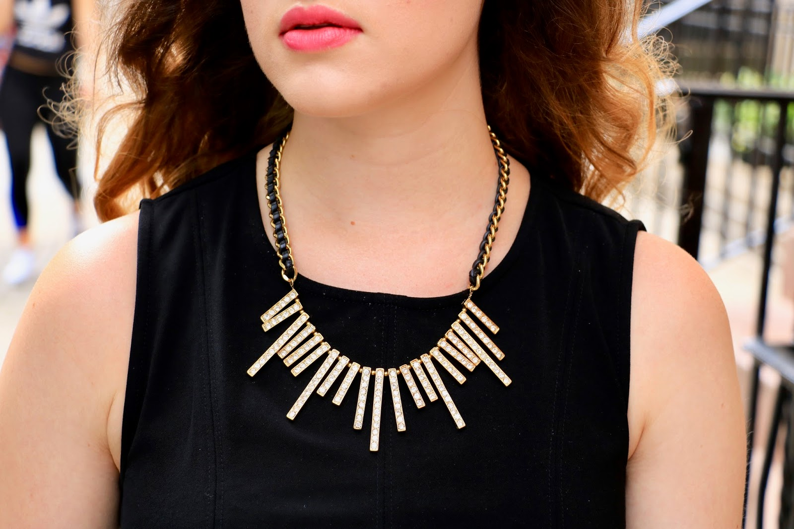 nyc fashion blogger Kathleen Harper wearing a gold and black statement necklace