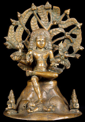 Shiva in his form as Dakshinamurthy, seated under a banyan tree, and dispensing wisdom