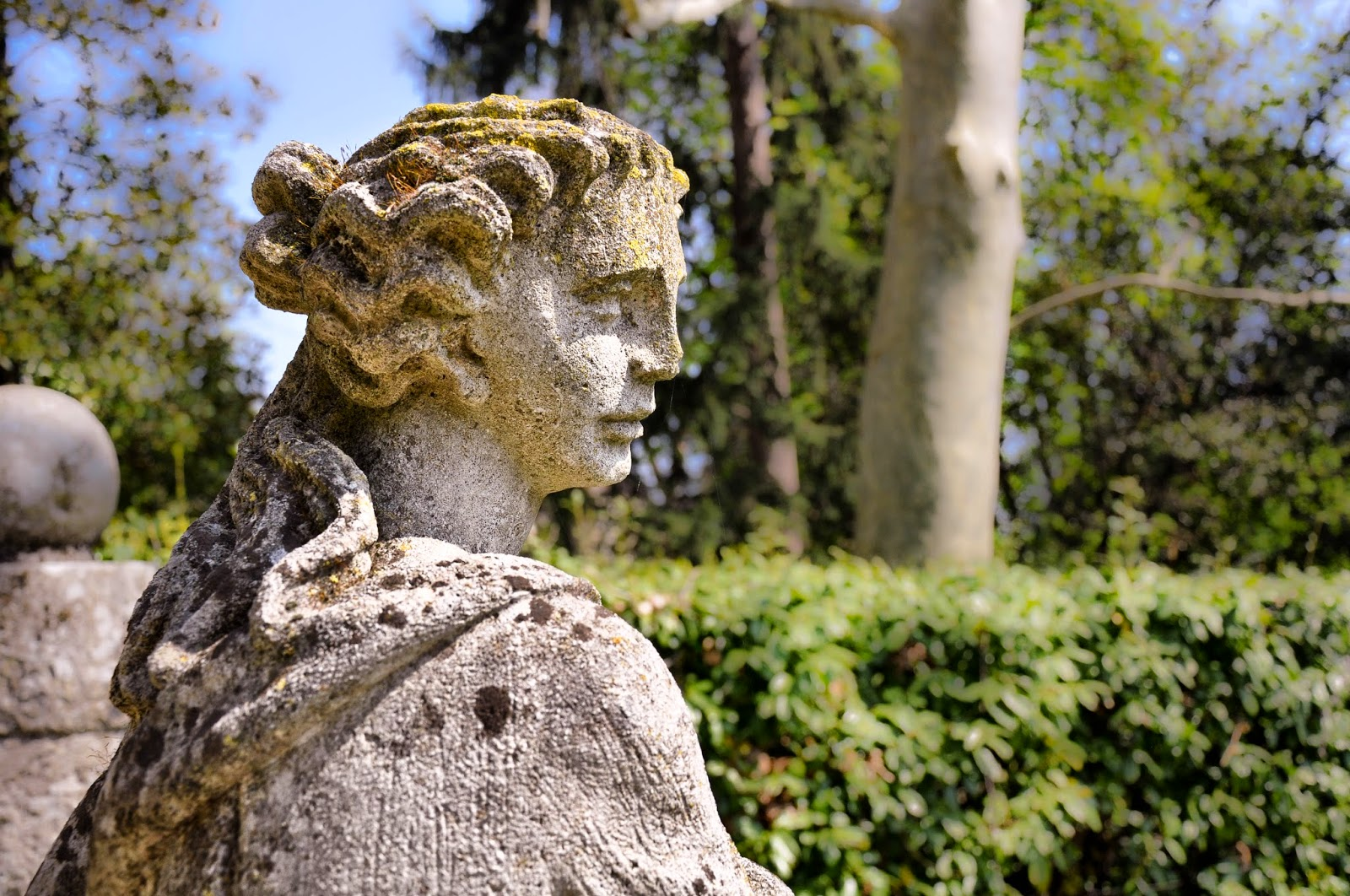 A pensive statue in the park of the Villa da Schio in Costozza, Italy