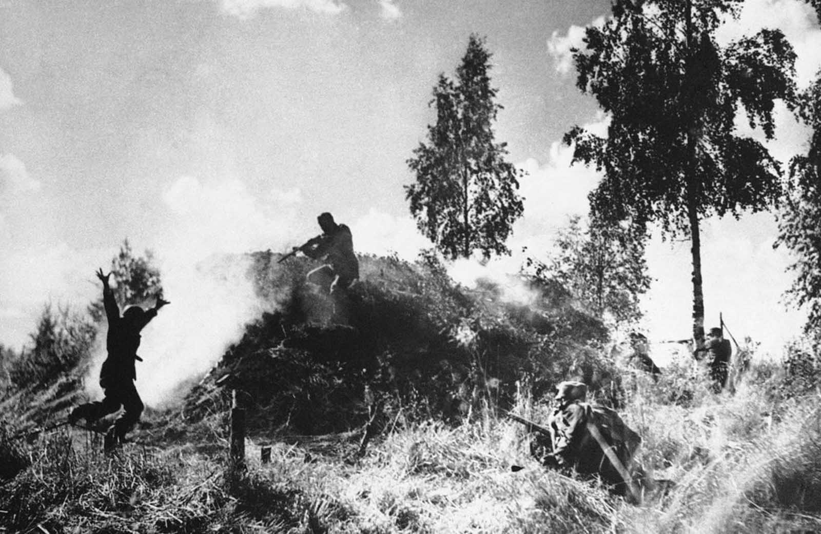 Finnish soldiers storm a soviet bunker on August 10, 1941. One of the Soviet bunker's crew surrenders, left.