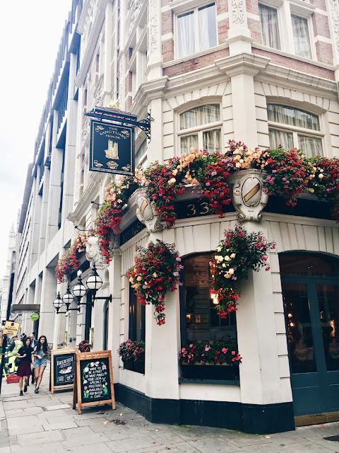 London street corner covered in flowers