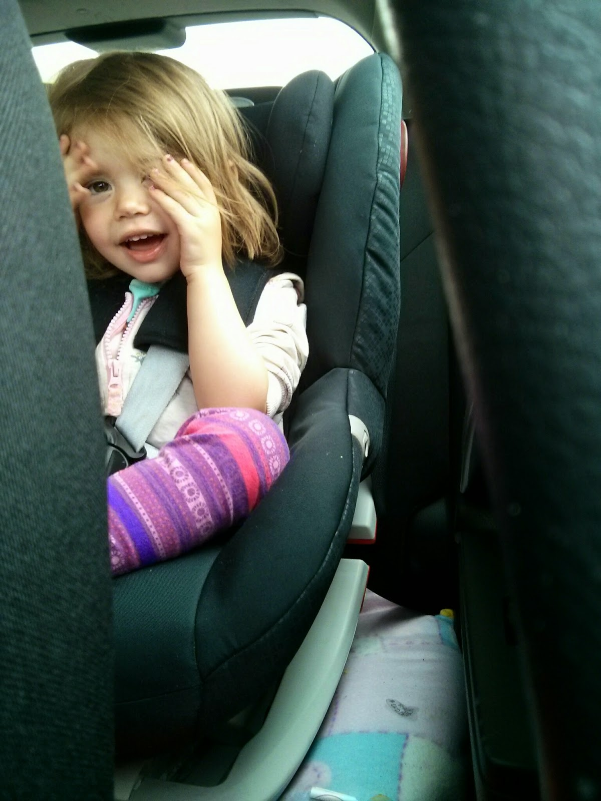 Peekaboo in car seat
