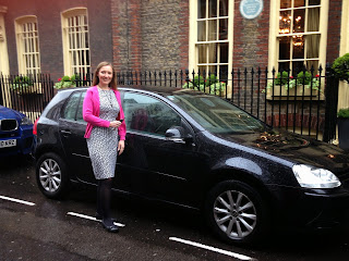 A volunteer in the Privilege Insurance driving survey stands by her car