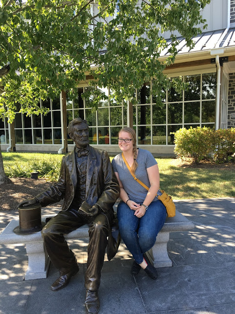 Meagan with a statue of Abraham Lincoln at the Gettysburg visitor center