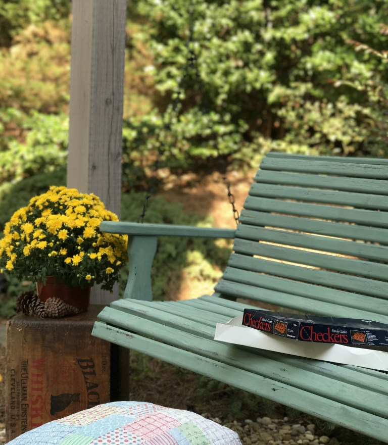 http://thechelseaproject.com/outdoor-porch-swing-makeover-with-milk-paint/