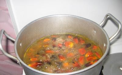 Boiling banga palm nuts