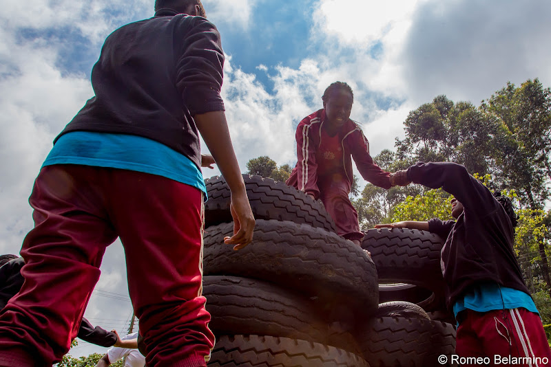 Ropes Course Tire Climb Volunteering in Kenya with Freedom Global