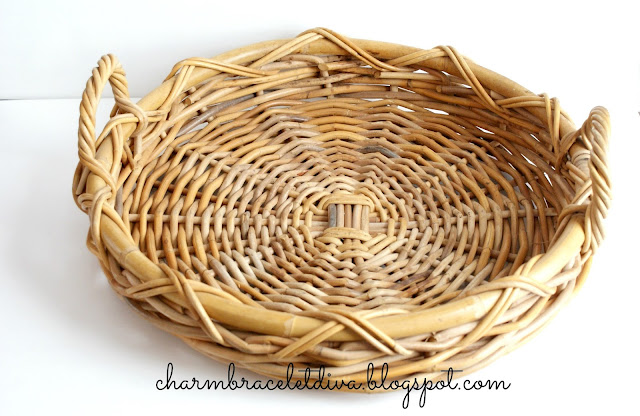 round, flat basket with handles