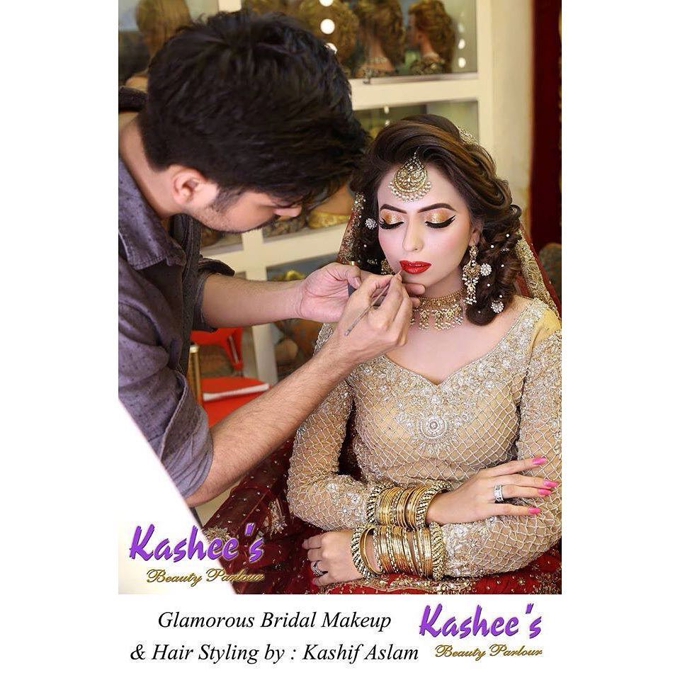 Kashif doing makeup for a bride