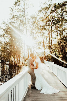 bride and groom at golden hour on pier