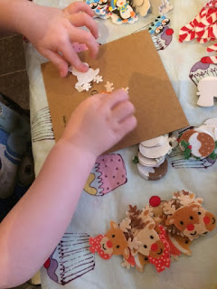 Toddler making cards