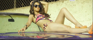 Capture.JPG  Surveen Chawla is an Indian film actress and dancer. Chawla made her television debut as Charu in the serial Kahin To Hoga. She then appeared in the reality dance show Ek Khiladi Ek Haseena, where she paired up with Indian cricketer S. Sreesanth.Surveen Chawla Shoots for her test bikini poshoot for Maxim Magzine.Surveen Chawla has no qualms about posing in bikini