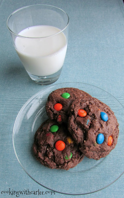 chocolate cookies on plate with glass of milk