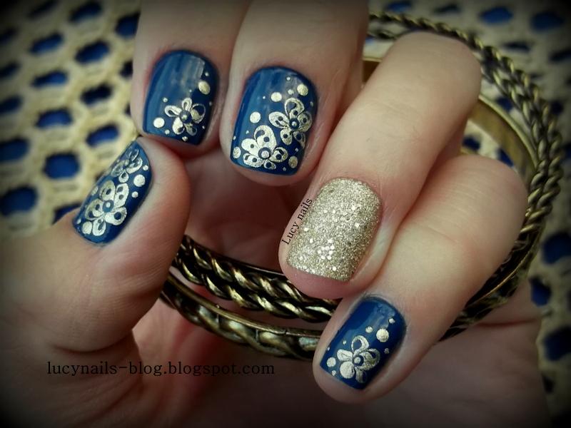 Granat i złoto na paznokciach