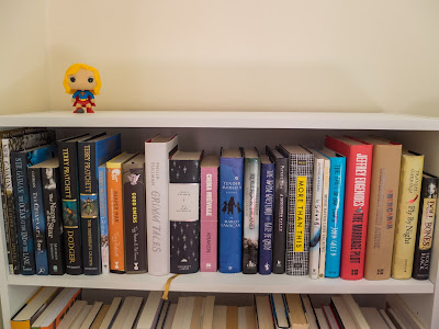 Top shelve up close: signed books by Neil Gaiman, Terry Pratchett, Philip Pullman, Margo Lanagan, Kate DeGoldi, Patrick Ness, John Green, Jeffrey Eugenides, Chimamanda Ngozie Adichie, Frances Hardinge and Holly Black