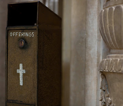 man steals catholic church offering box