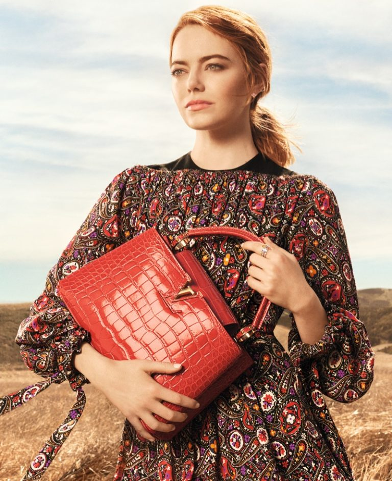 Actress Emma Stone poses with Capucines bag in Louis Vuitton 'Spirit of Travel' campaign