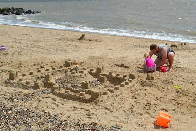 A large sandcastle on the beach