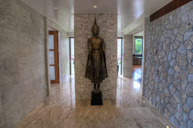 Statue and stone wall in the hallway of Villa Liberty, Phuket