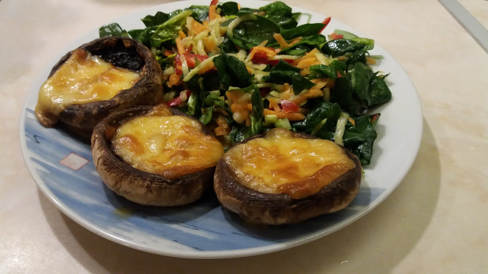 YELLOW CHEESE STUFFED MUSHROOMS IN AN OVEN