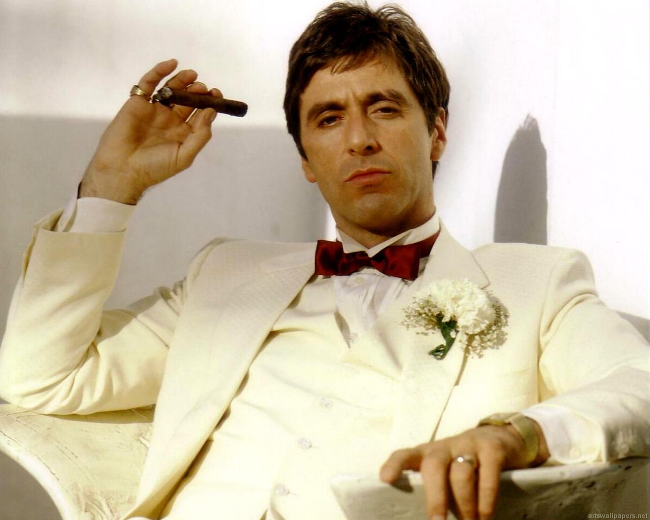 In a DePalma film, the badguys often wear white!