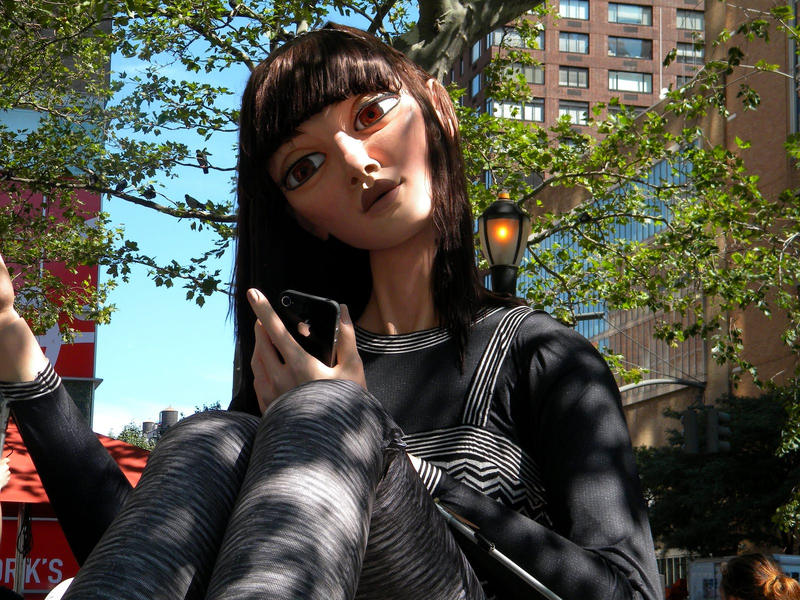 Marina, the 25-foot tall Missoni-clad doll who likes to blogger and tweet