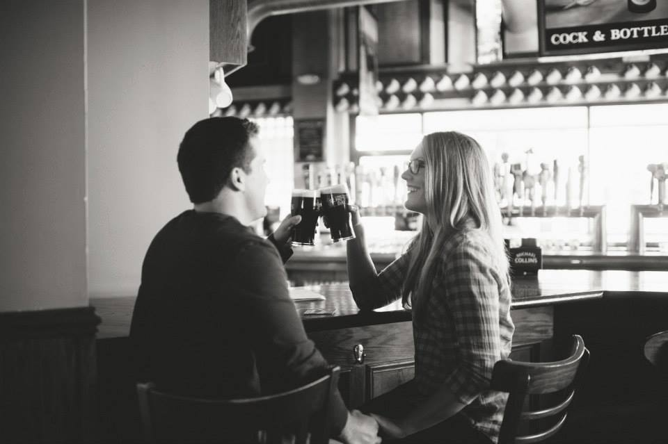 oklahoma city blogger amanda martin shares a drink with her husband at McNellie's in Midtown