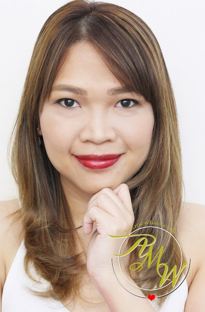 a photo of Nikki Tiu AskMEWhats wearing L'Oreal Infallible 10H LongWear Lipstick Persistent Plum