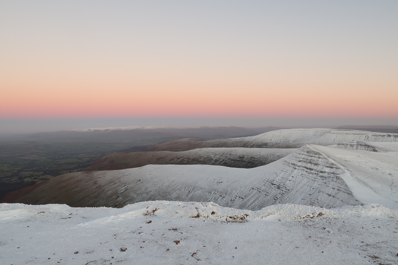 pen y fan mountain at sunset in the snow
