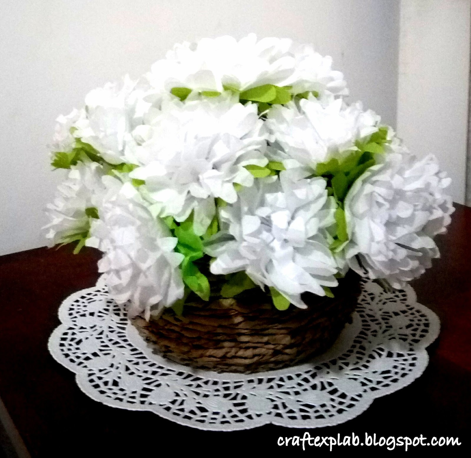 Craft lab white tissue paper flower and paper bag basket now open the white layers up and green once downue a stem to the center on the green siderange the flowersr presentation i have used a white doily mightylinksfo