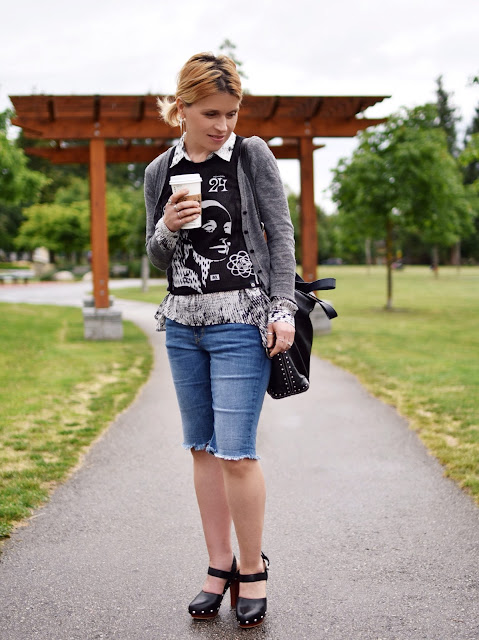 styling knee-length denim shorts with a layered shirt, tank, and cardigan, and Vince Camuto shoes