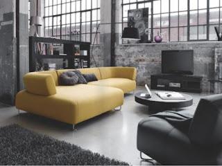 Sala con mucho estilo y colores obscuros