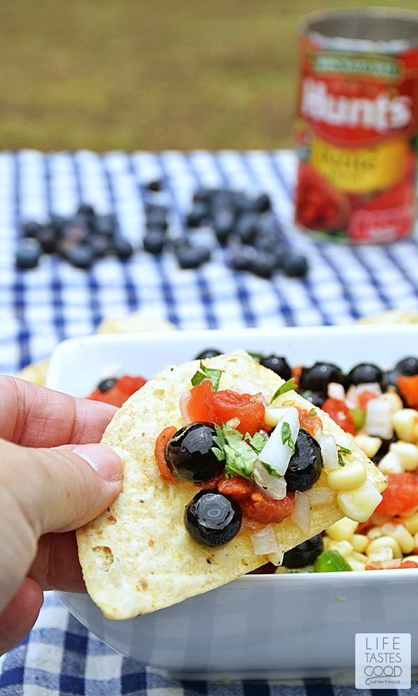 Red, White, and Blueberry Salsa | by Life Tastes Good is a unique blend of sweet & savory that is perfect with your favorite chips, but also delicious as a topping for fish, chicken, and even pork for an easy dinner any night of the week!