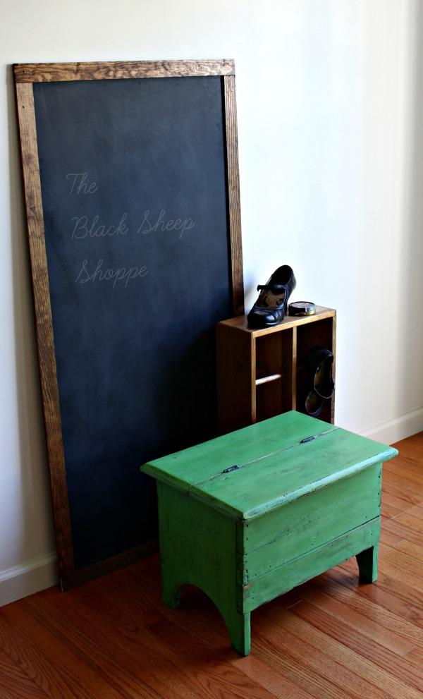 Chalkboard and shoe shine box.