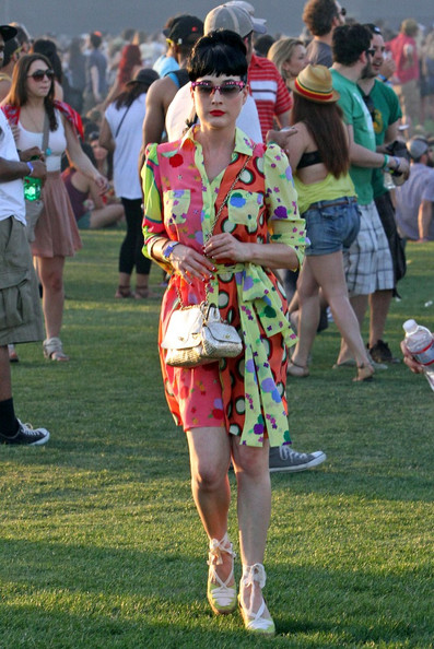 1195a10c70f2 Dita Von Teese showed off some colorful and fun looks as she attended the  Coachella Music Festival this year.
