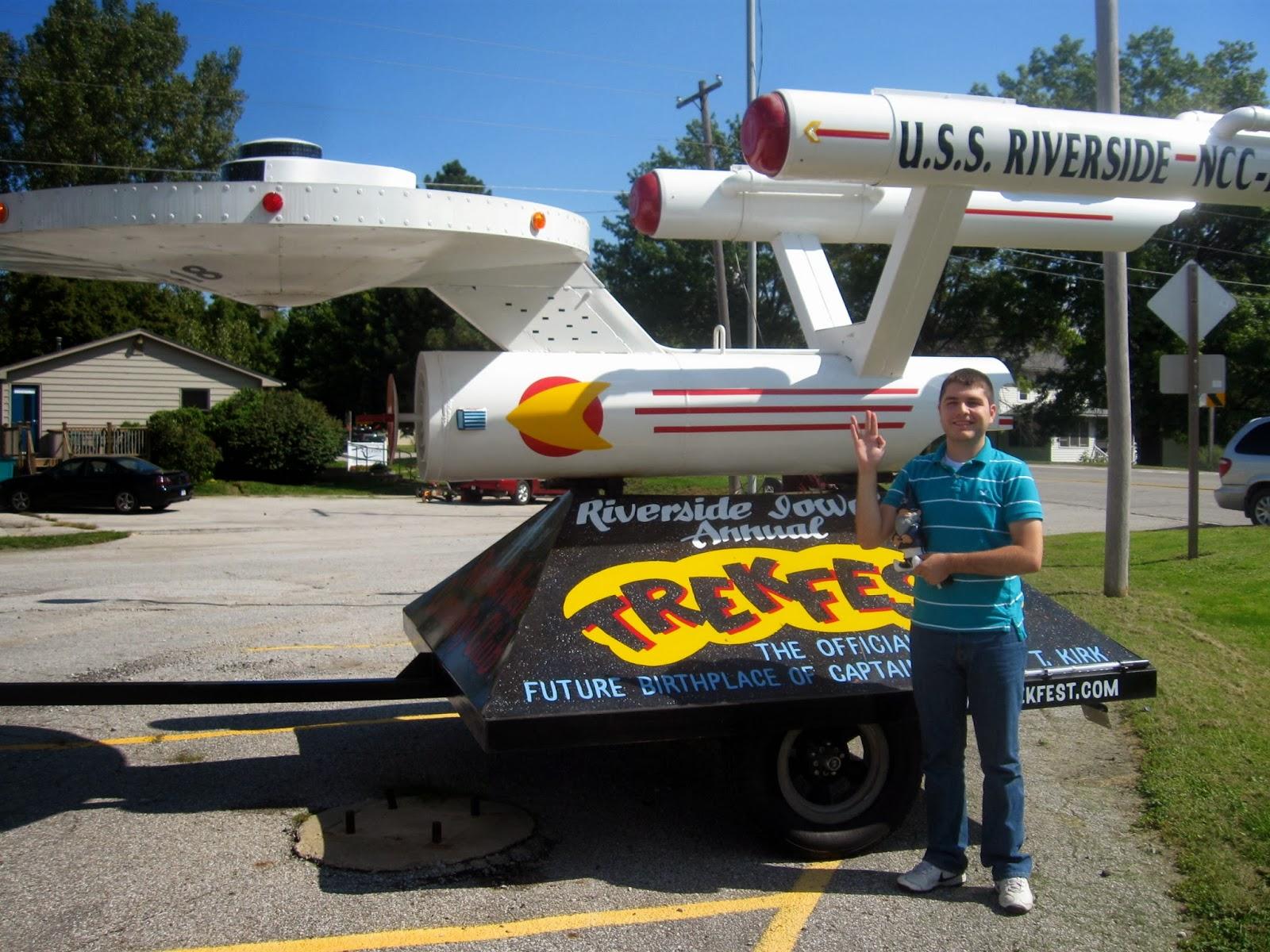 man posing with trekfest float