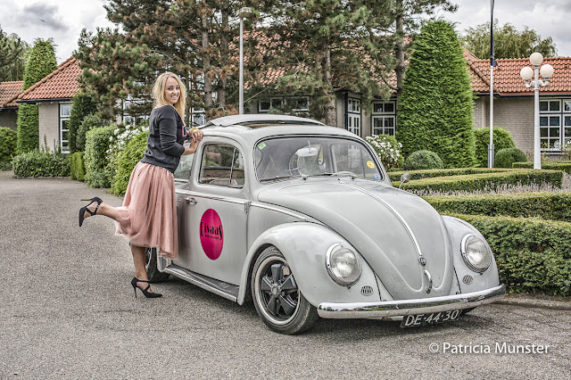 Chantal in front of VW beetle with tulle skirt