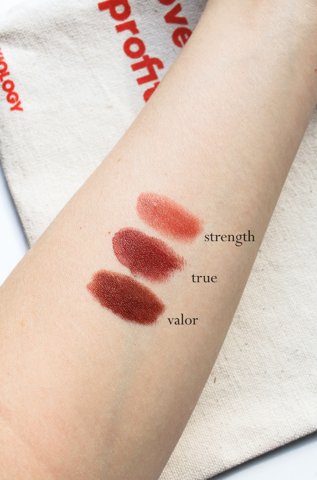 Axiology Limited Edition Makeup Discovery Spring Lip Collections Beauty Heroes. Vegan, palm oil free. Strength Sheer Balm Lipstick, True Rich Cream Lipstick, Valor Lip Crayon swatches