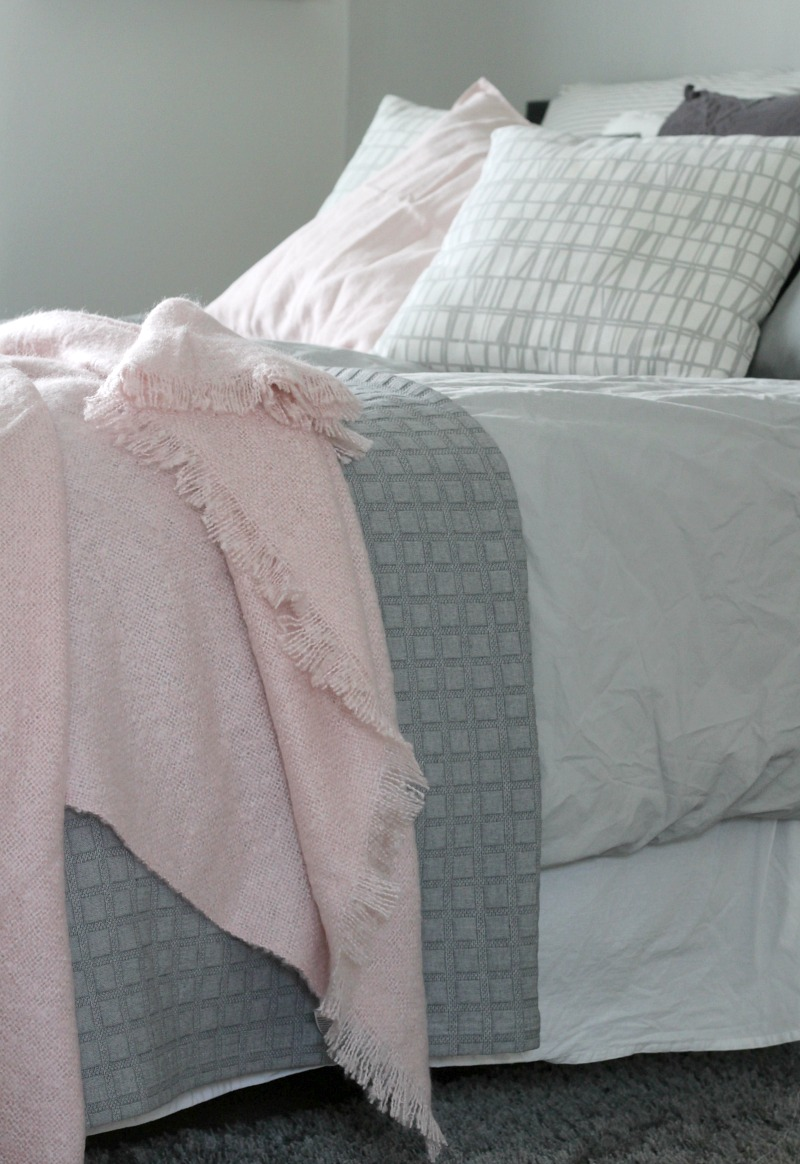 grey bedroom with pink details