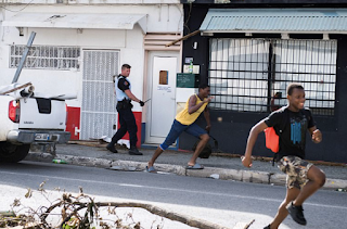 Anarchy In the Caribbean: Escaped prisoners and hundreds of looters armed with guns and knives terrorise hurricane-hit islands as police from Britain and France are flown in to restore order